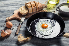 Breakfast with fried eggs and bread Royalty Free Stock Images