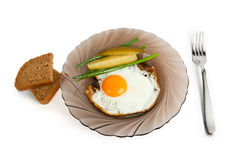 Breakfast fried eggs on a glass plate Royalty Free Stock Photos