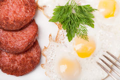 Breakfast with fried eggs and sausage on  plate Stock Images