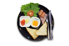 Breakfast with fried eggs, sausage, toast royalty free stock photos