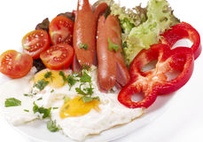 Breakfast with fried eggs and sausages. Appetizing breakfast with fried eggs fried eggs and fried sausages Royalty Free Stock Photo