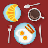 Breakfast with fried eggs, sausages, croissant and cup of coffee Royalty Free Stock Images