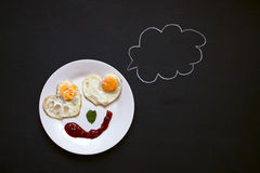 Breakfast, fried eggs in the shape of hearts, smiley,bright morn stock images