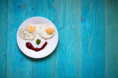 Breakfast, fried eggs in the shape of hearts, smiley,bright morn Royalty Free Stock Photos