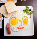 Breakfast with fried eggs, toasts and juice Royalty Free Stock Image