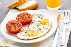 Breakfast with fried eggs and tomato Royalty Free Stock Photo