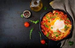 Breakfast. Fried eggs with vegetables - shakshuka Stock Photo