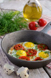 Breakfast with fried quail eggs with cherry tomatoes Stock Photo