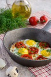 Breakfast with fried quail eggs with cherry tomatoes Royalty Free Stock Photo