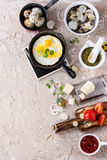 Breakfast with fried quail eggs Royalty Free Stock Images