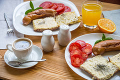 Breakfast with fried sausages, cheese toasts and coffee Stock Photography