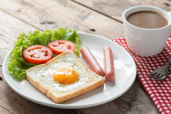 Breakfast, Fried toast with egg, sausage and a cup coffee. Stock Image