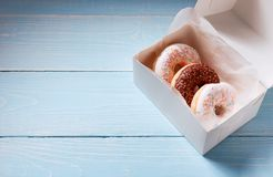 Breakfast for friends, donuts in a box royalty free stock photography