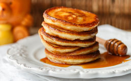 Breakfast. Fritters with honey  on a white plate.  Homemade pancakes Stock Image