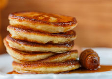 Breakfast. Fritters with honey  on a white plate.  Homemade pancakes Royalty Free Stock Images