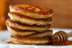 Breakfast. Fritters with honey  on a white plate Royalty Free Stock Image