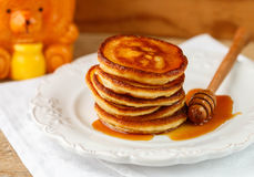 Breakfast. Fritters with honey  on a white plate.  Homemade pancakes Stock Photography