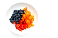 Breakfast fruit. Fruit; cut up strawberries and apricots with blueberries stock image