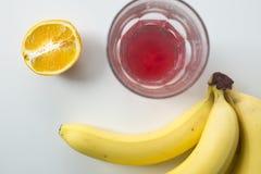 Breakfast Fruit Arrangement with Juice and Sliced Orange Stock Image