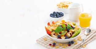 Breakfast with fruit and berry salad, juice and cereal Stock Photos