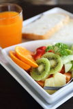 Breakfast fruit bread and orage juice Royalty Free Stock Photography