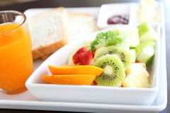 Breakfast fruit bread and orage juice Royalty Free Stock Photos