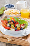 Breakfast with fruit salad, cornflake and orange juice, vertical Stock Photos