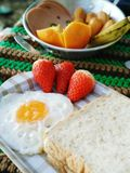 Breakfast with fruit on the table. Royalty Free Stock Images