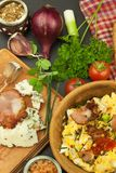 Breakfast full of protein. Scrambled eggs and bacon. A hearty meal for athletes. Homemade recipe for eggs. Stock Photos