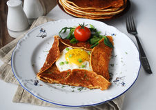 Breakfast galette with sunny side up egg and fresh salad Stock Photo