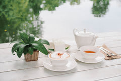 Breakfast in the garden. With Coffee, Cake and Tea stock images
