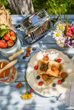 Breakfast in the garden with toast and fruit Stock Photography