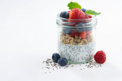 Breakfast in a glass jar, chia with berries and oat flakes Stock Photography