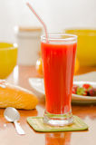 Breakfast and glass of red juice on wooden table Royalty Free Stock Photos