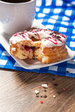 Breakfast with glazed donut and coffee cup Royalty Free Stock Photography