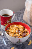 Breakfast golden and chocolate cornflakes cereal bowl Stock Photos