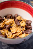 Breakfast golden and chocolate cornflakes cereal bowl Stock Photo