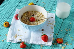 Breakfast for the good health. Of the cereals with strawberries and milk on a light green background Royalty Free Stock Photo