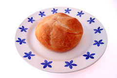 Breakfast grains. Fresh bun on a porcelain plate Royalty Free Stock Photography