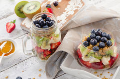 Breakfast with granola and berries in glass jar. Stock Photo