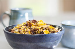 Breakfast granola with blue ceramics, shallow depth of field Stock Photo