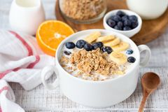 Breakfast granola bowl with banana and blueberries royalty free stock images