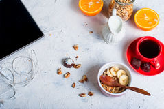 Breakfast granola, a cup of coffee and phone Royalty Free Stock Photo
