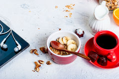 Breakfast granola, a cup of coffee and phone Stock Photos