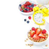 Breakfast with granola, fresh berries, milk and alarm clock Stock Image