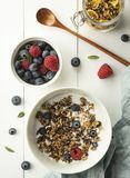 Breakfast granola with milk blueberry raspberry cornflakes top view wood background royalty free stock images