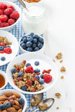 Breakfast with granola, yogurt and berries on a white wood Royalty Free Stock Image