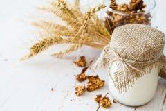 Breakfast - granola, yogurt, wheat. Breakfast - granola yogurt wheat, white wood background, copy space Stock Photo