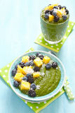 Breakfast green smoothie bowl topped with fruits Royalty Free Stock Images