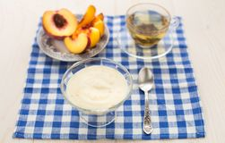 Breakfast. Green tea, youghurt and peach Royalty Free Stock Image